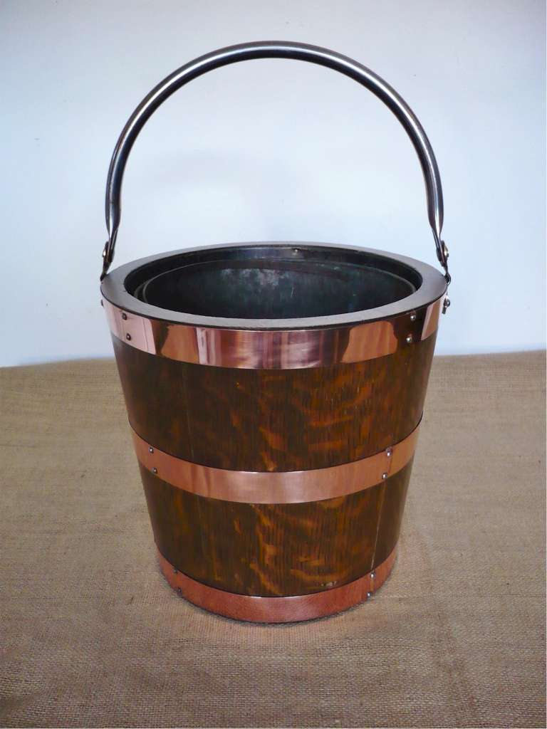 Circular coopered coal bucket in oak and copper