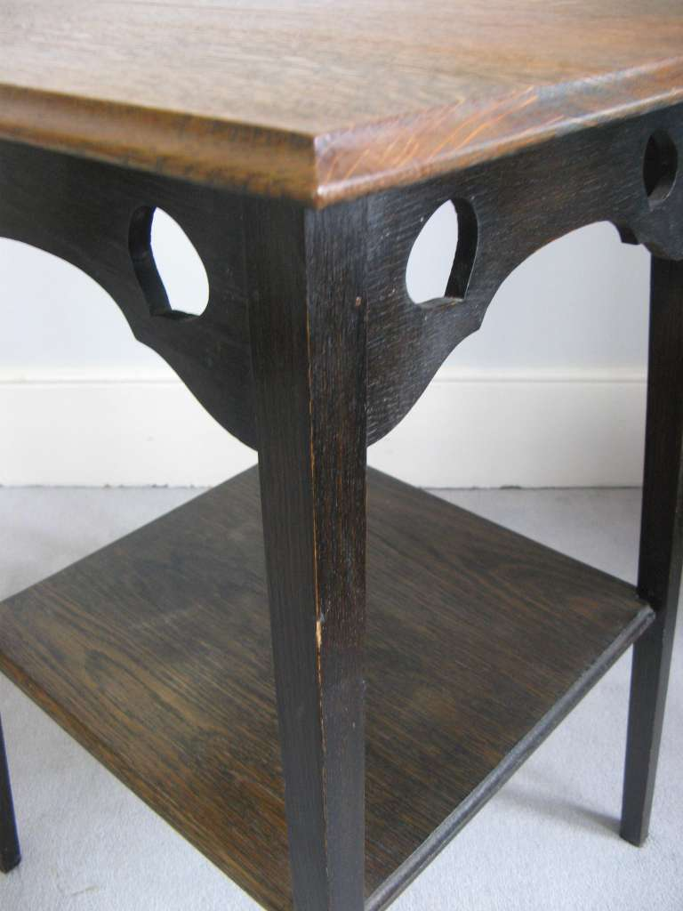 arts and crafts oak side / lamp table with pierced heart decoration