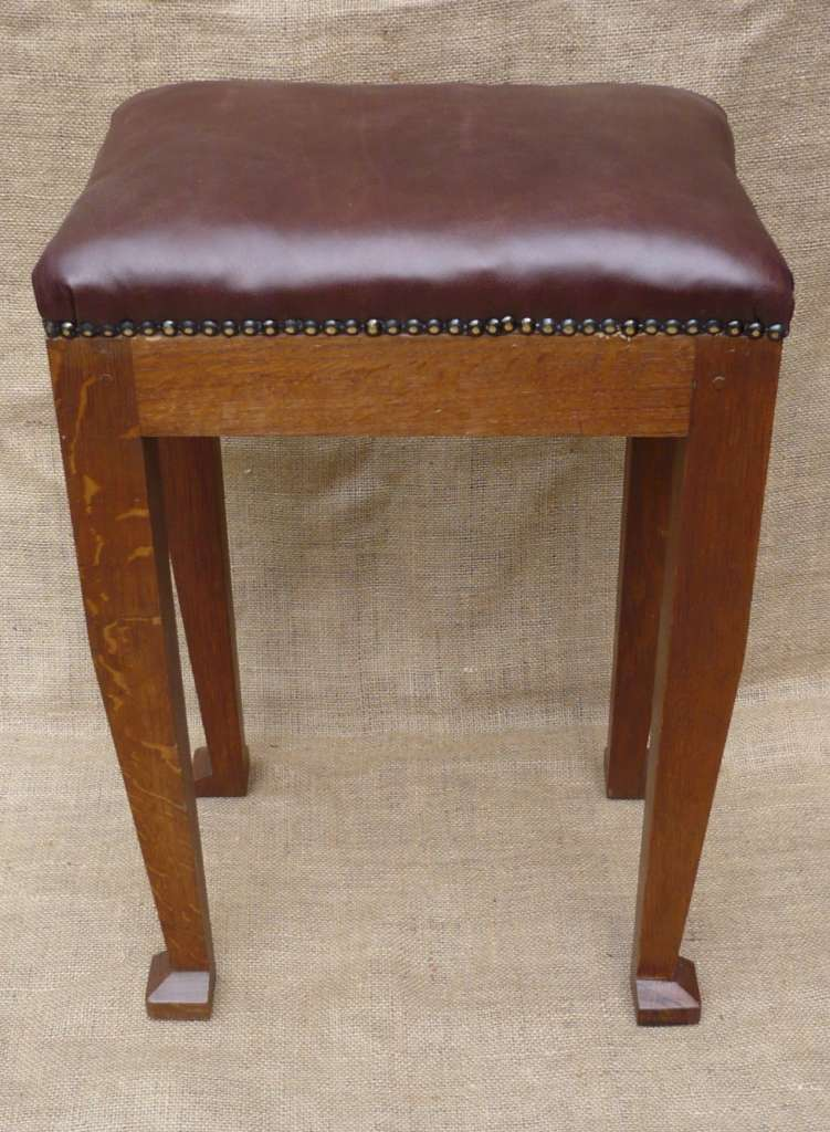 Leather topped stool in oak