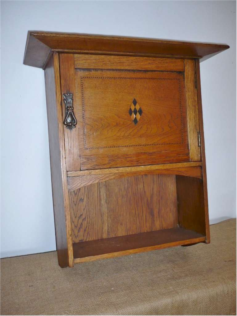 Arts and crafts hanging wall cupboard in golden oak