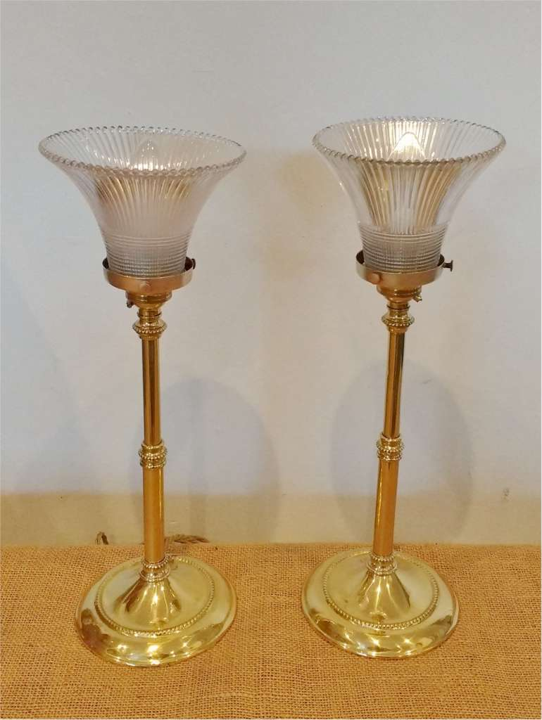 Pair of brass table lamps with Holophane shades
