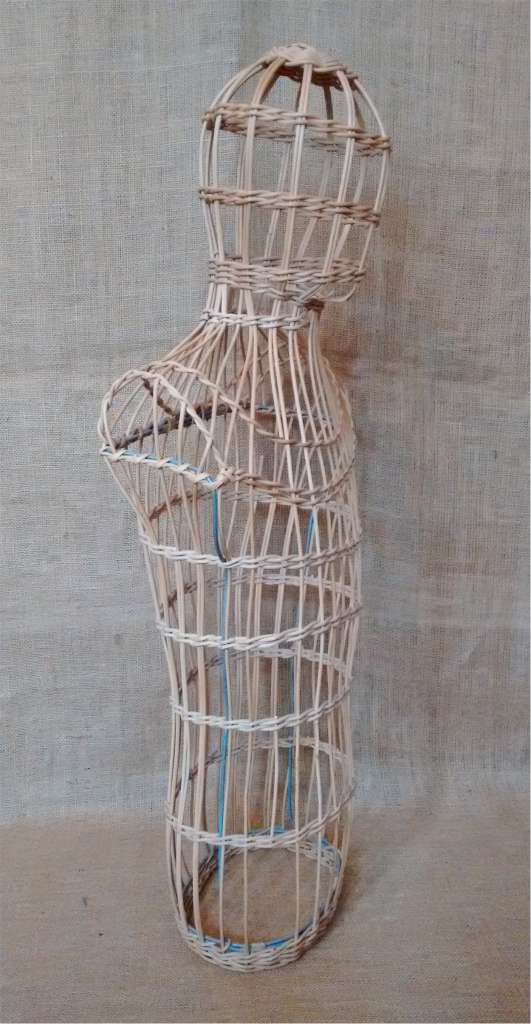 Wicker mannequin of male , head and body .
