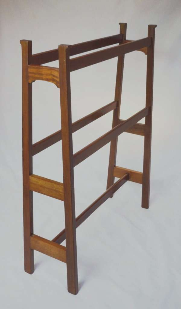 Arts and crafts towel rail of tapered construction