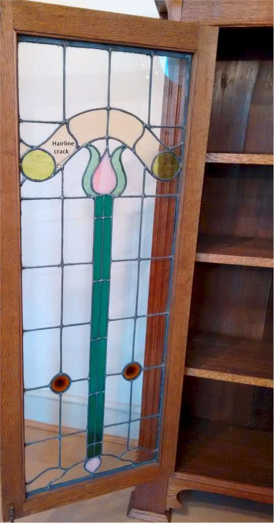 Larger arts and crafts bookcase , leaded glass
