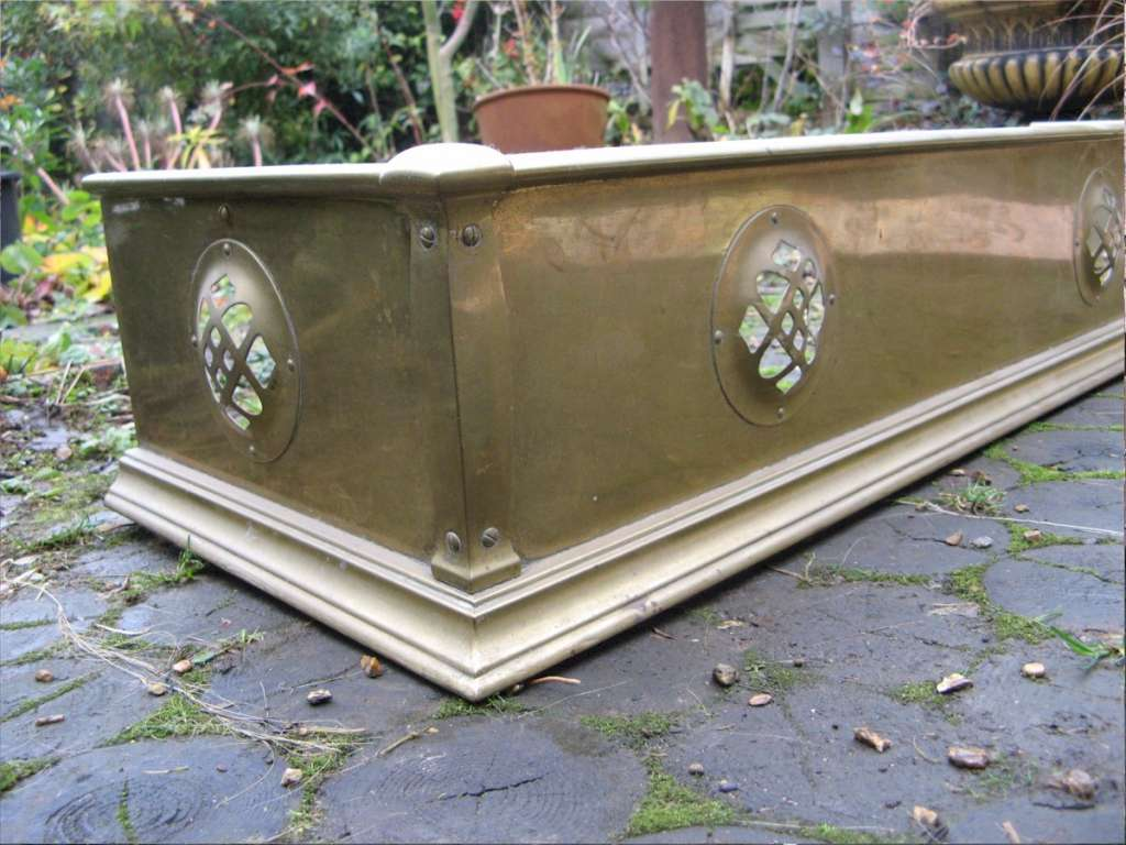 arts and crafts brass fire fender with stylised pierced cut outs