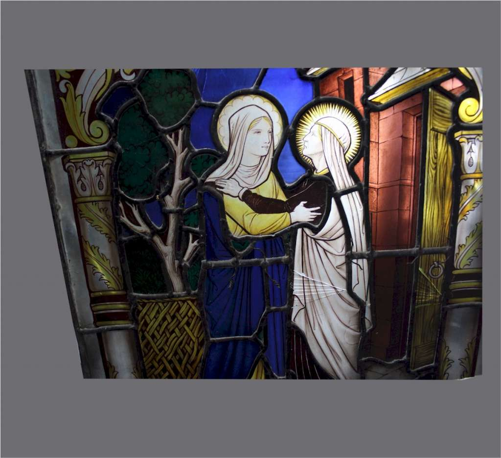 Religious stained glass with two female figures
