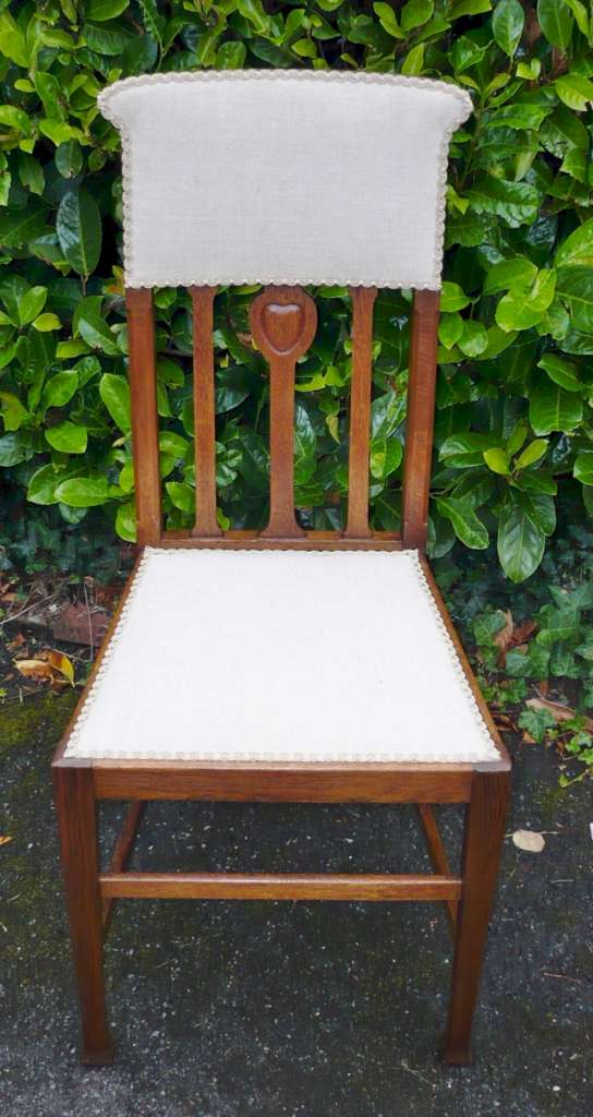 Set of six arts and crafts chairs in golden oak