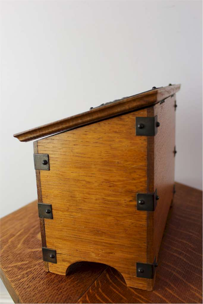 Arts and Crafts oak stationary box made from quarter sawn oak with stylised brass mounts
