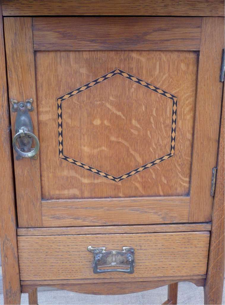 Arts and crafts inlaid cabinet in golden oak