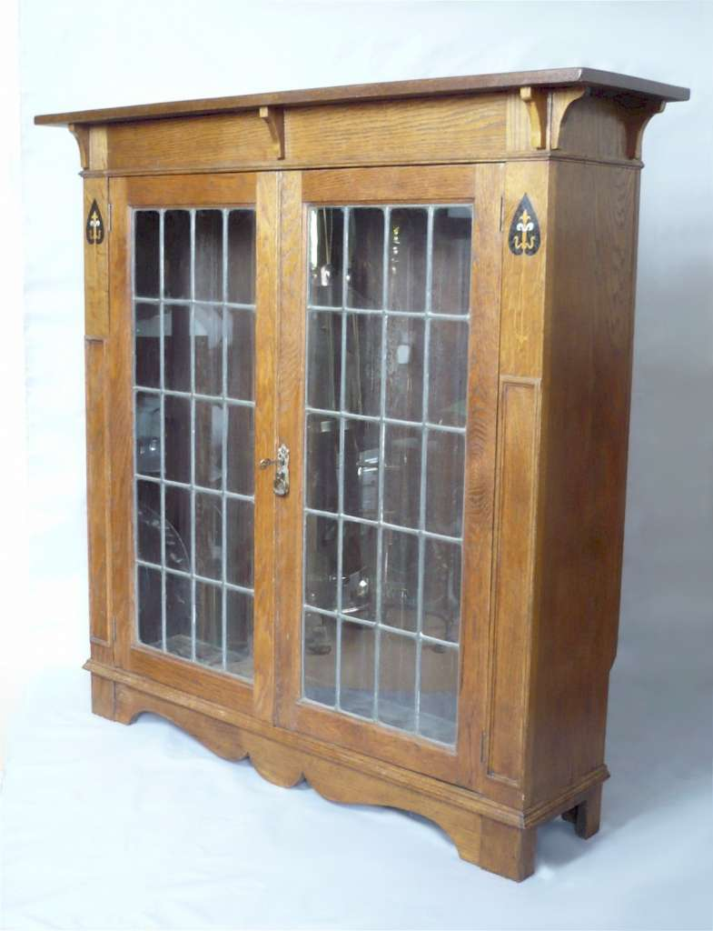 Arts and crafts bookcase with leaded glass doors
