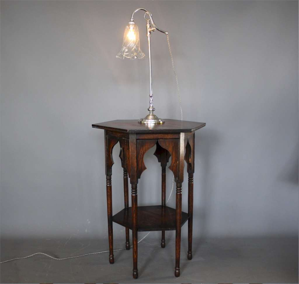 Elegant Edwardian adjustable table lamp with clear glass shade.