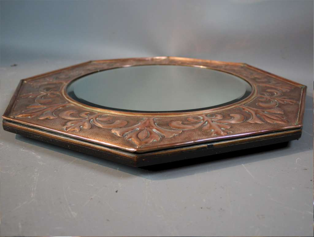 KSIA copper arts and crafts mirror.