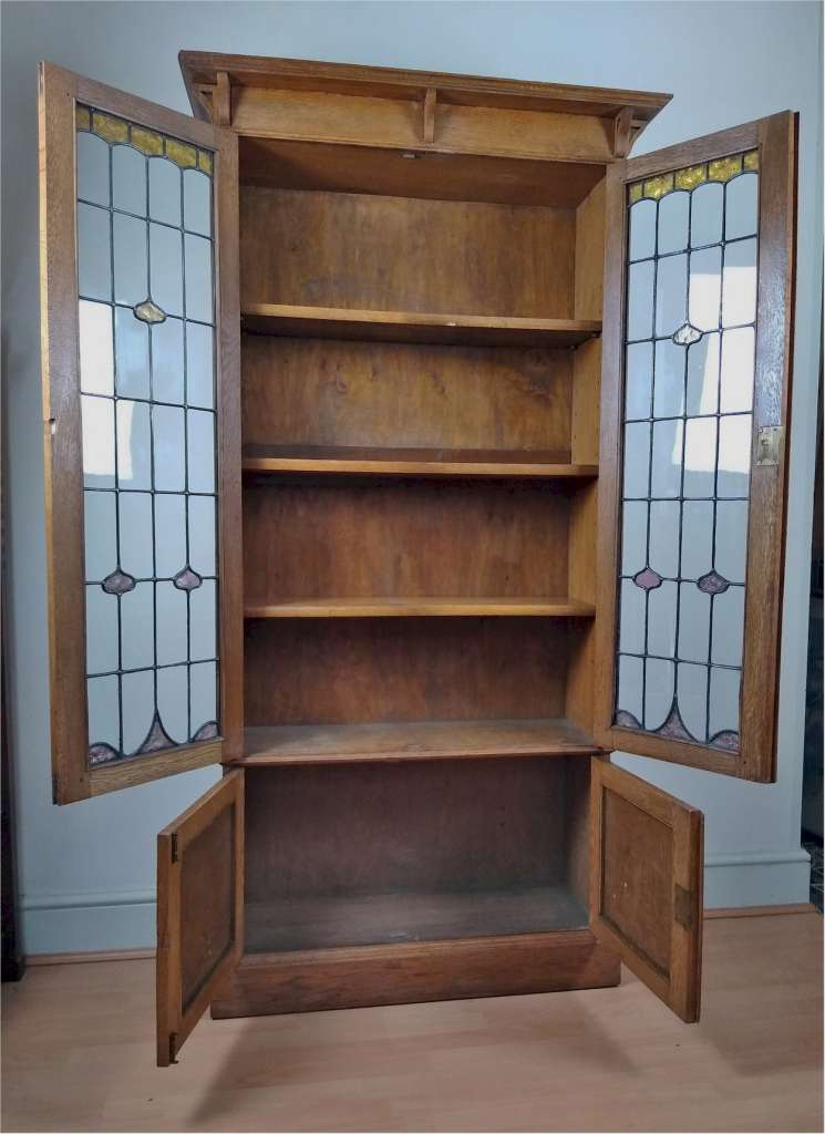 Arts and crafts oak bookcase with strap hinges