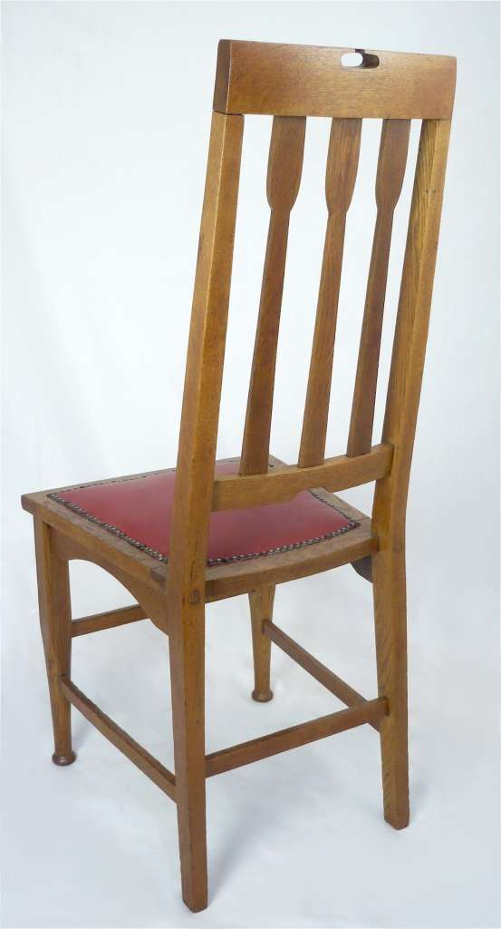 Good set of 8 arts and crafts chairs , golden oak