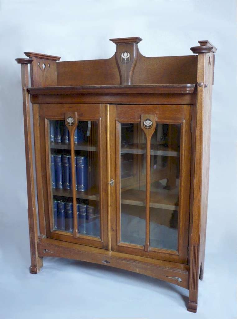 Arts and crafts bookcase , pewter ebony and boxwood inlay