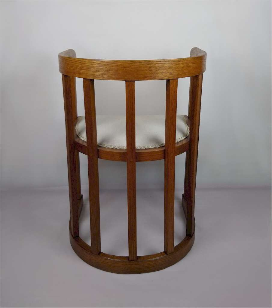 Arts and crafts barrel shaped armchair in oak