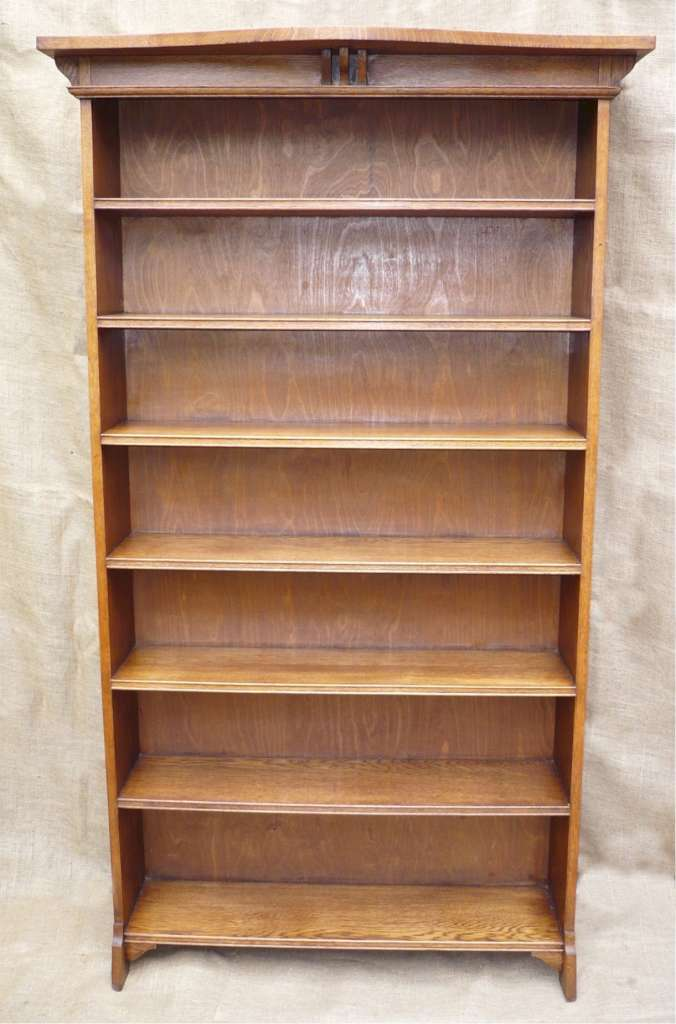 Pair of tall arts and crafts bookcases in golden oak 1
