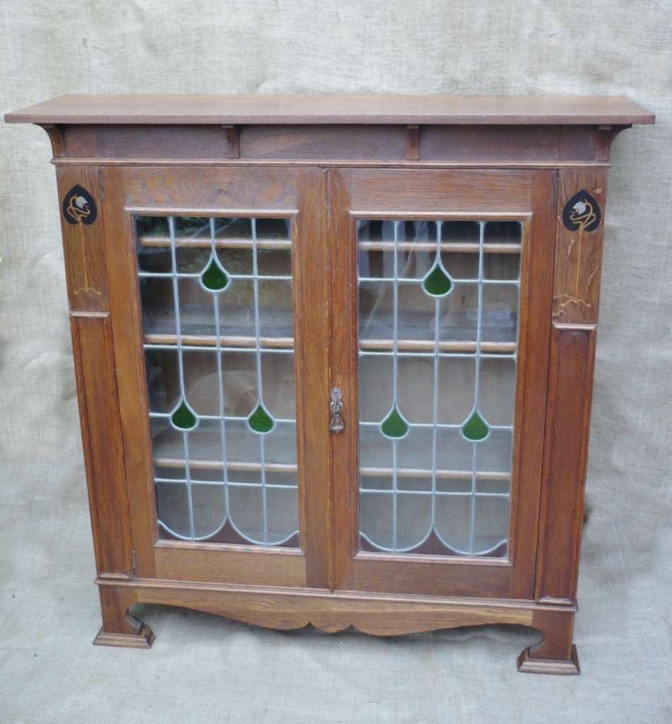 Arts and crafts bookcase in oak with pewter inlay
