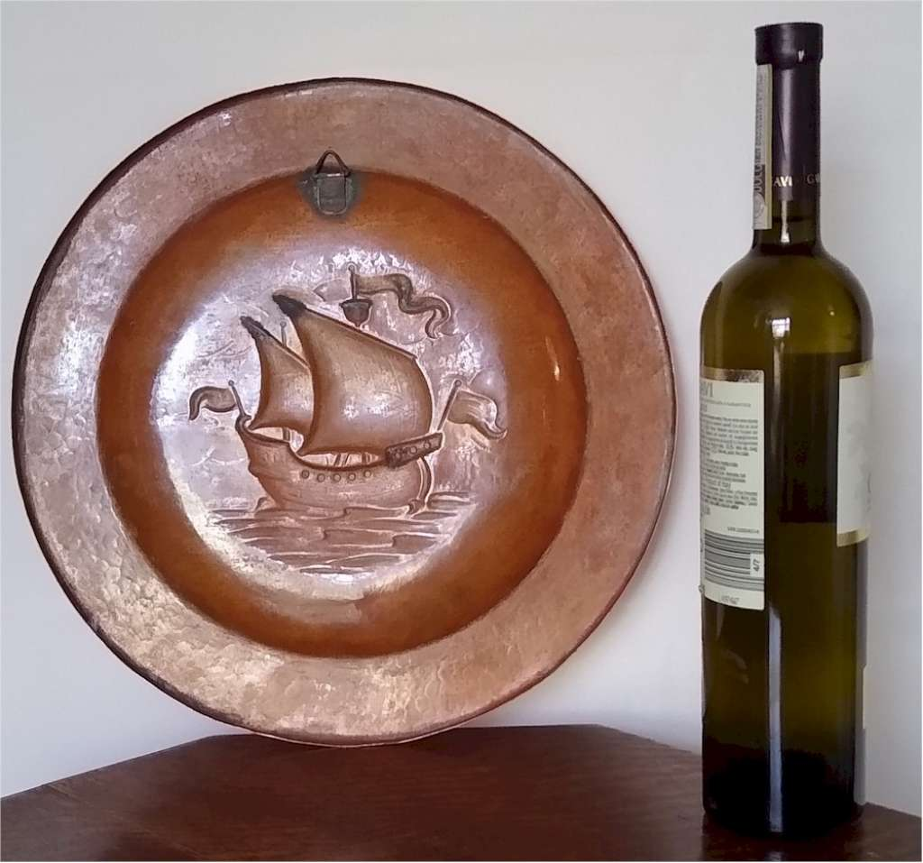 Newlyn arts and crafts charger in hammered copper