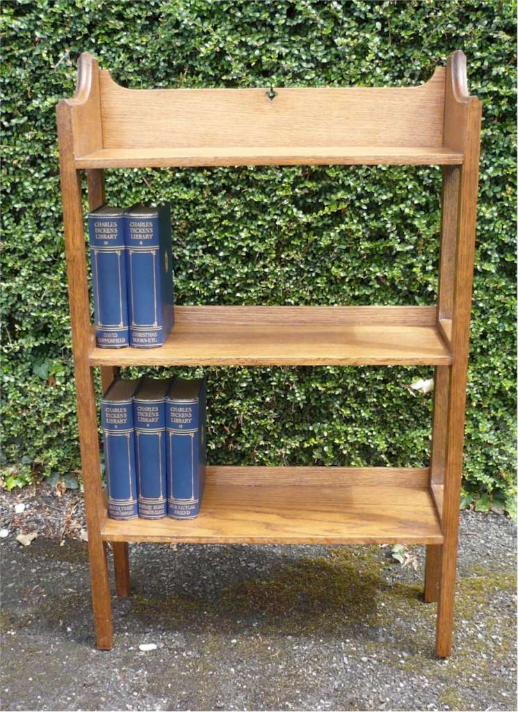 Small arts and crafts bookcase with heart cut out