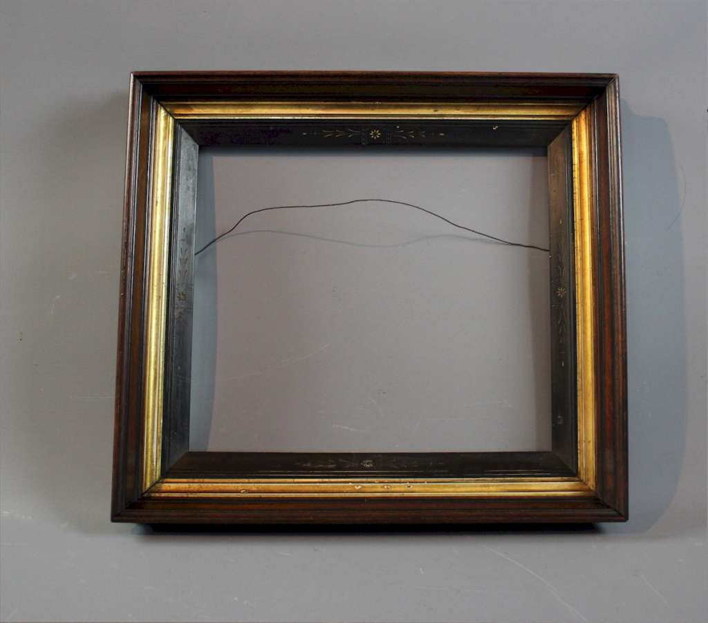 Aesthetic movement mahogany picture frame.