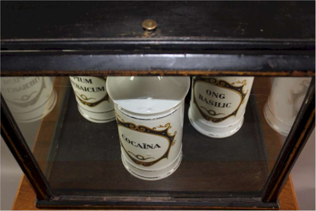 Antique display cabinet and three Apothecary jars by Limoges