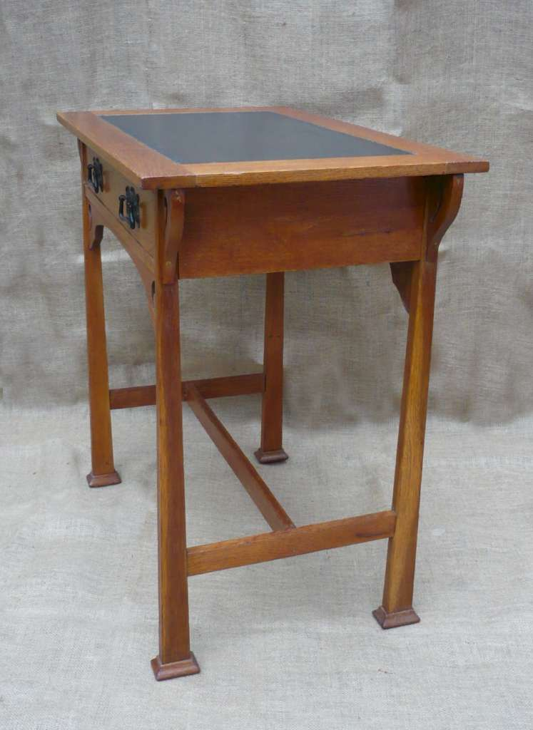 Arts and crafts desk in golden oak with drawer