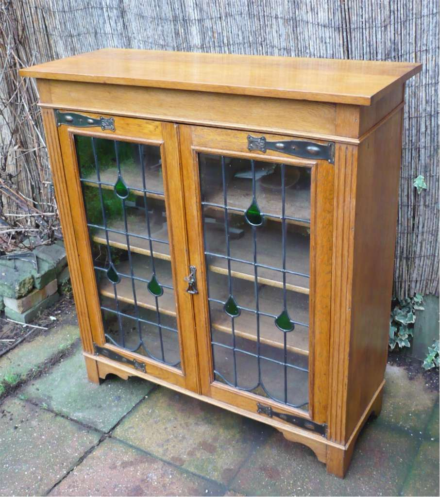 Deep arts and crafts bookcase in golden oak