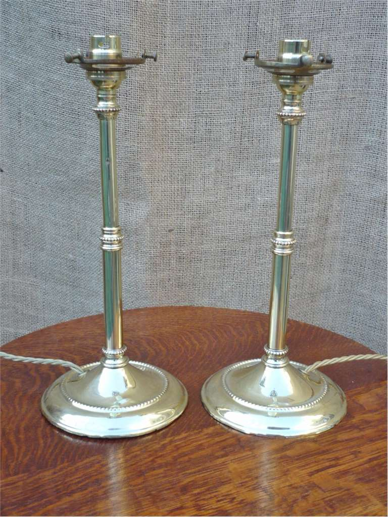Pair of brass table lamps with tulip shades