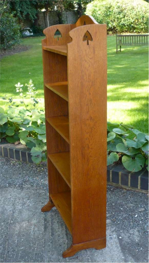 Arts and crafts bookcase with spear cut outs
