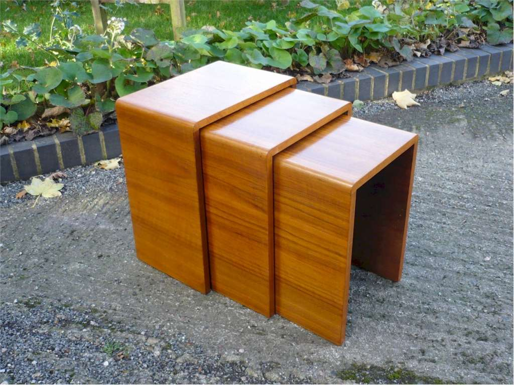 Small nest of figured walnut tables probably by Heals