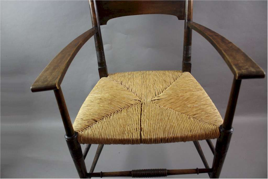 An arts and crafts carver chair by William Birch