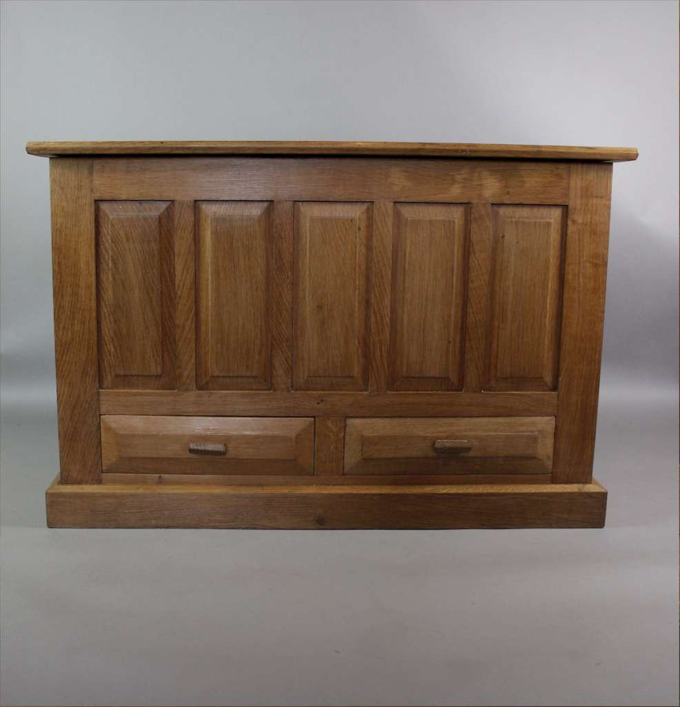 Oak blanket box with fielded panels in the manner of Heals and the Cotswold school