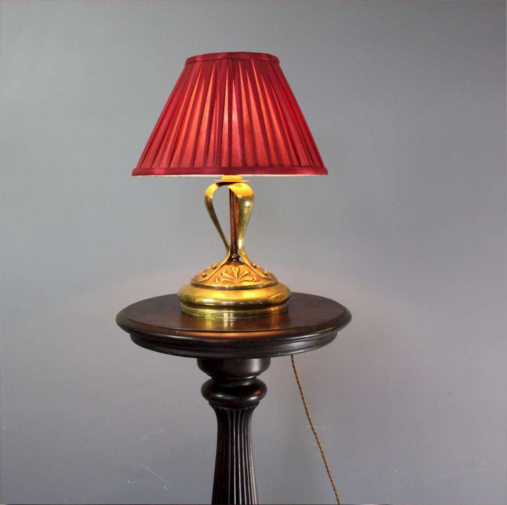 Art Nouveau brass table lamp with pleated red shade