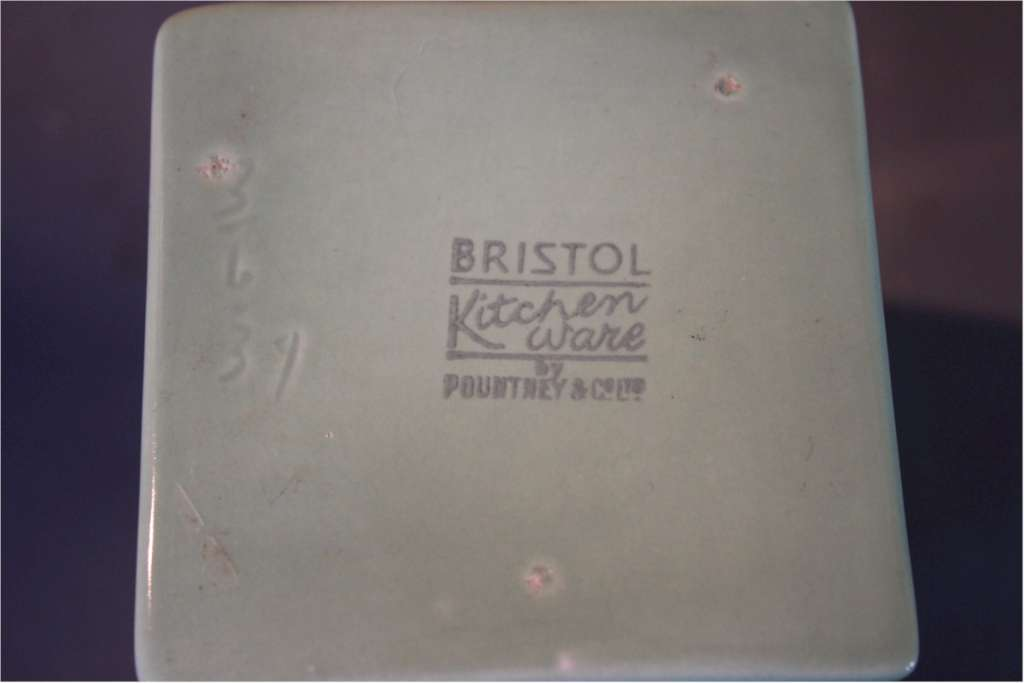 Part collection of Bristol Ware green kitchen containers.