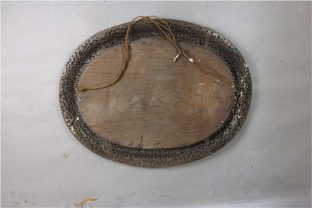 Antique Burmese carved hard wood oval wall mirror.
