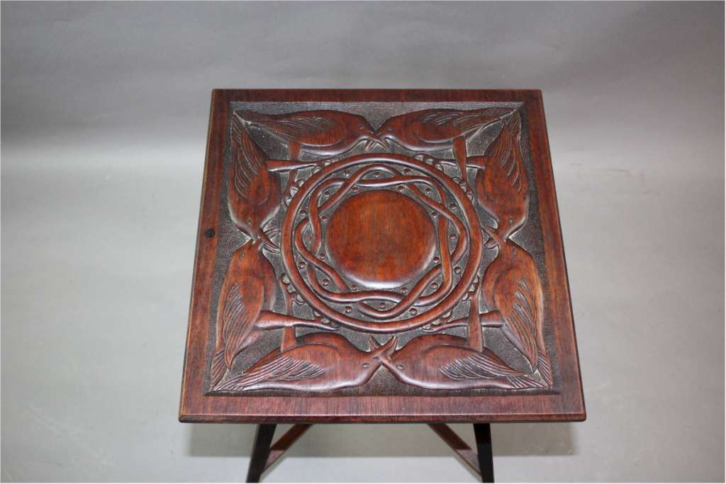 Arts and crafts table with carved birds c1900