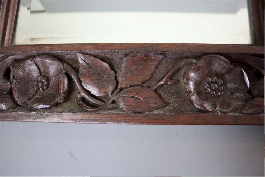 Arts and crafts period carved mirror