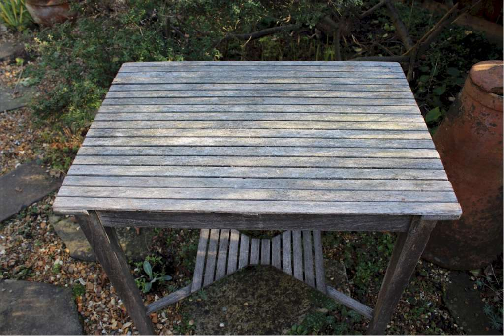 Weathered teak garden table by Castles ship breakers.