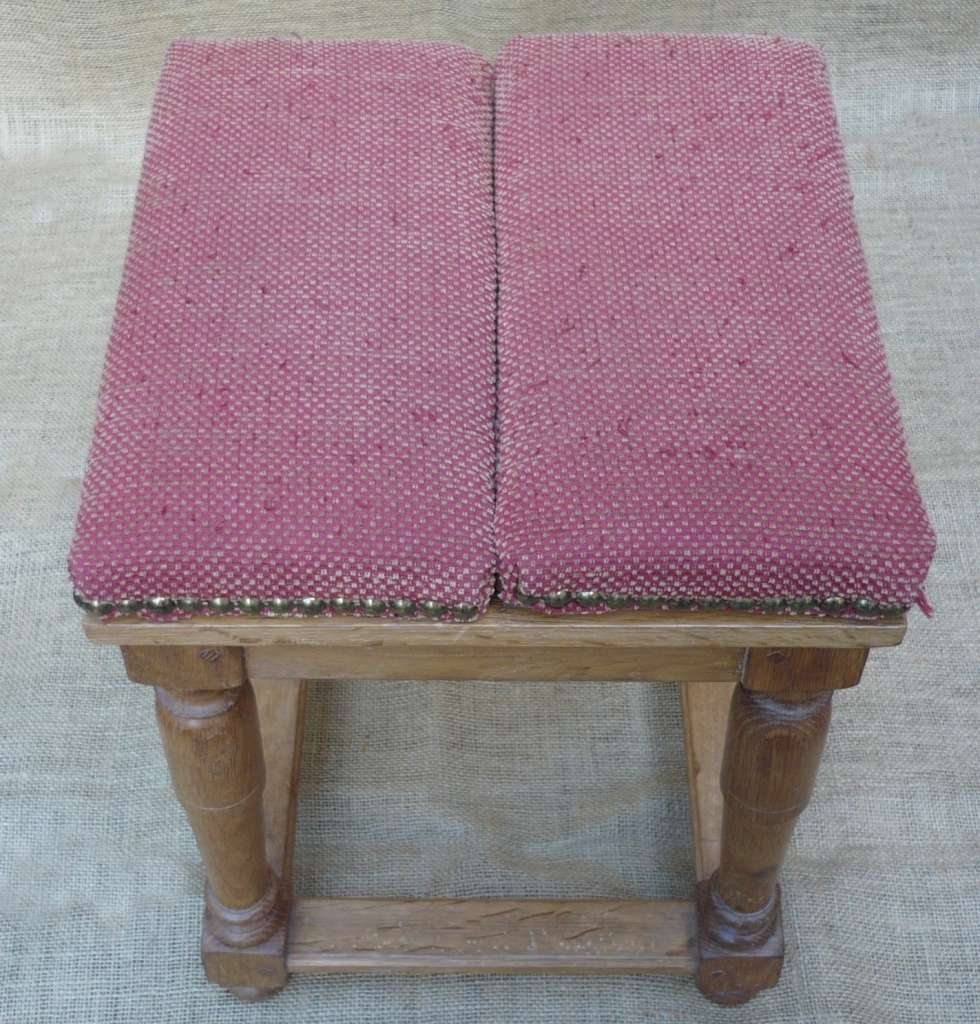 Unusual upholstered stool converts to table