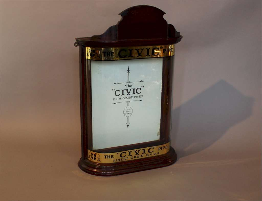 Lovely small bow fronted Civic pipe display cabinet