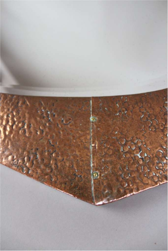 Arts and Crafts period wall mirror in hammered copper frame