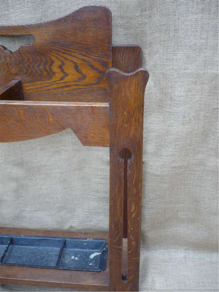 Arts and crafts umbrella stand in oak with stylised decoration