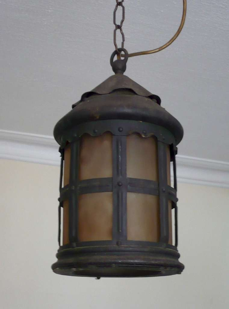 Iron porch light with glass liner
