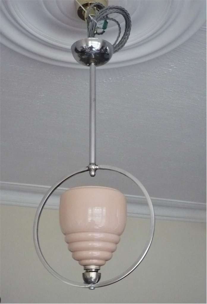 Art Deco ceiling light in chrome , peach glass shade