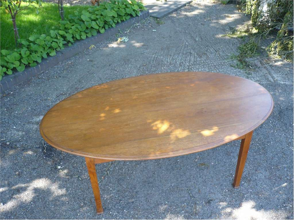 Arts and crafts oval dining table in golden oak