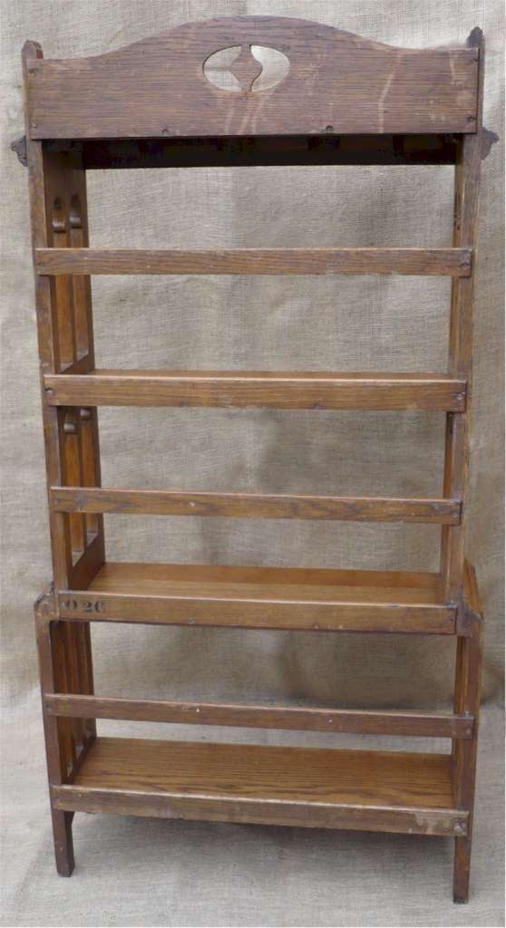 Arts and crafts side arched bookcase in golden oak