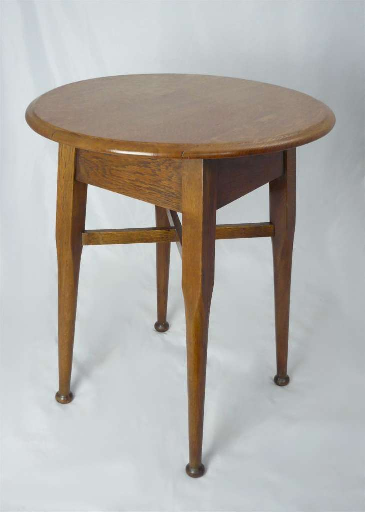 Arts and crafts circular topped table in golden oak