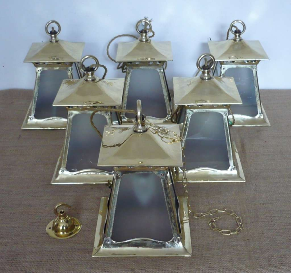 Good run of arts and crafts lanterns in brass