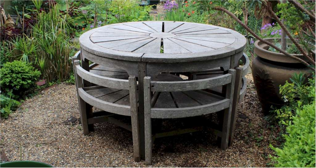 Rare weathered teak garden set by Hughes Bolckow